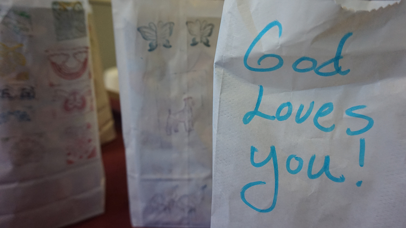 Picture of a bag of goodies that say God Loves You - Is your helping hurting